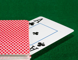 playing cards on green cloth