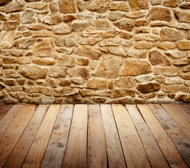 stone wall with wooden floor