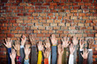 Group of Diverse Casual People's Hands Raised Concept - 77871523