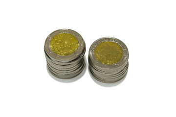 A few coins on a white background