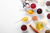 Various Spicy Rubs and Marinades on White Table