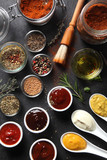 Assorted Seed Type Spices and Sauces on the Table
