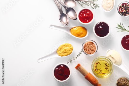 Deurstickers Grill / Barbecue Various Spicy Rubs and Marinades on White Table