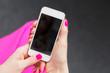 Leinwanddruck Bild - Woman holding mobile phone