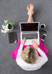 Smart woman working with computer, view from above