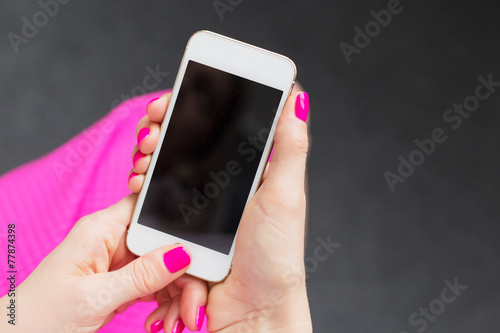 Woman holding mobile phone - 77874398