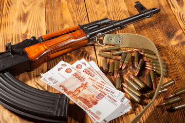 Kalashnikov rifle and Russian rubles
