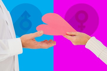 Composite image of woman handing man a paper heart