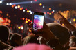 Leinwanddruck Bild - People holding their smartphones and photographing concert