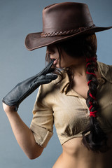 girl cowboy on a gray background