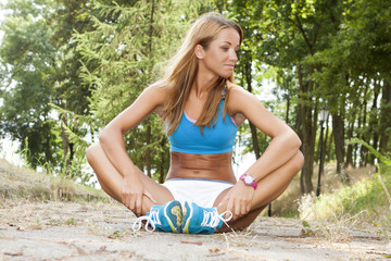 Fit woman stretching her leg outdoor
