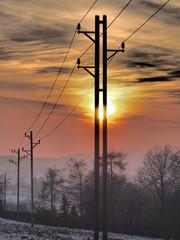 Strommast und Sonnenuntergang