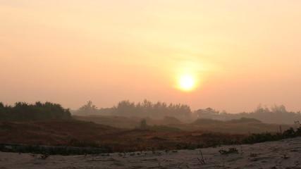 beautiful bright sunrise in orange tropical valley
