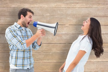 Angry man shouting at girlfriend through megaphone