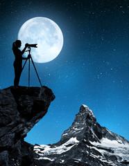 Photographer photographing Matterhorn in night - Swiss Alps