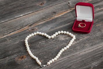 Engagement emerald ring and string of pearls. Valentine's day