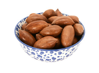 Pecan nuts in a blue and white china bowl