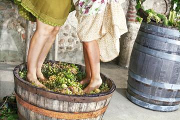 women pounding grapes
