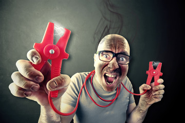 man need energie holding red elettric wires