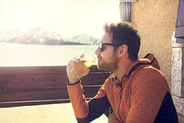 sitted and relaxed man drinking a beer in peace