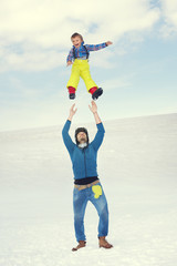 father throw his son in to the sky in mountain