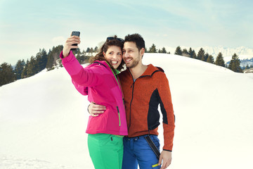 couple making a selfie on the snow