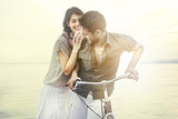 Fototapety couple in love pushing bicycle together