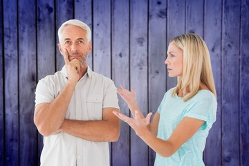 Unhappy couple having an argument with man not listening