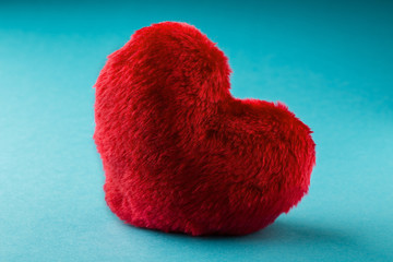 fluffy heart on blue background