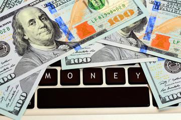 money on computer keyboard