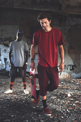 happy Young skater ready to show his skills in an urban place