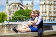Dating couple near Notre-Dame in Paris