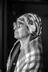 elderly woman in   scarf and  glasses