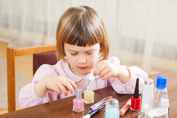 Little girl making manicure