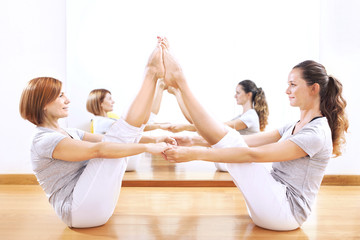 women finding body balance throw a phisical exercise
