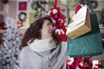 woman in shop look satisfied her shopping bags