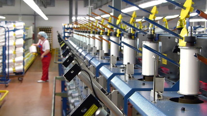Textile manufacturing of synthetic fibers