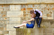 Young couple having fun at Parisian embankment
