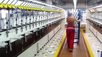 Textile manufacturing of synthetic fibers, woman working