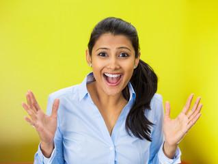 beautiful woman looking shocked surprised in disbelief