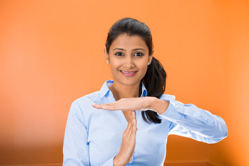 smiling woman showing a time out gesture with hands