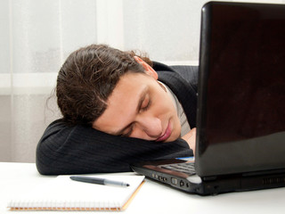 Office worker falling asleep at desk