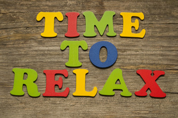 Time To Relax text on a wooden background
