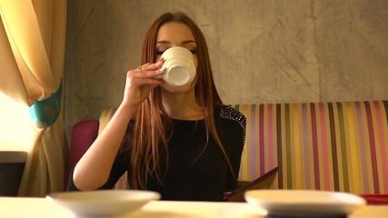 Girl shocked by a restaurant bill