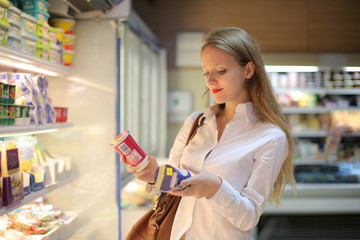 Undecided girl at the supermarket