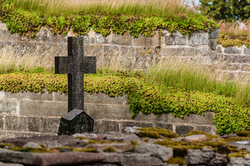 Graveyard with stone cross at an old monastery ruin.