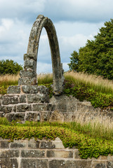 Old stone arch at a monastery ruin in Sweden.