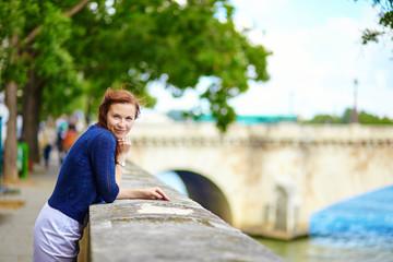 Smiling beautiful young woman in Paris