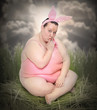 Overweight woman as a funny Easter Bunny.
