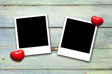 Blank valentine photo frames on wood background